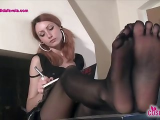 redhead schoolgirl teases with her five toes pantyhose